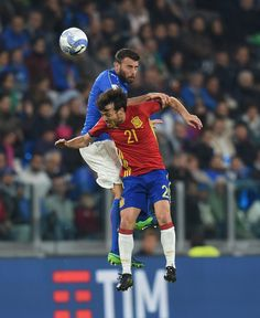 Andrea Barzagli of Italy and David Silva of Spain fight for the ball during the FIFA 2018 World Cup Qualifier between Italy and Spain at Juventus Stadium on October 6, 2016 in Turin, Italy.