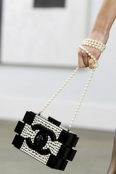 Chanel Spring/Summer 2014 (interpretation) (accessories) (structuralism) http://fashionbagarea.blogspot.com/  We can spot a chanel clutch from a mile off. Those golden studs are set perfectly against the chic tan shade.$159 Want!