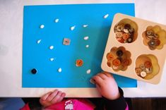 Toddlers make ART + practice fine motor skills. Add small objects to glue dots.