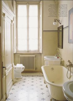 Traditional bathroom featured in World of Interiors