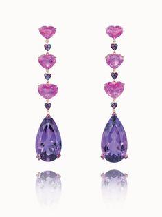 CHOPARD Orecchini Happy Diamonds in oro rosa 18ct dotati di tre diamanti mobili.