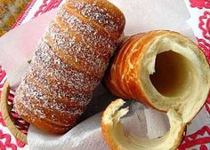 Kürtőskalács - a Hungarian pastry also known as chimney cake or stove cake. It is baked on a tapered cylindrical spit over an open fire. In the past decades, it became popular to bake it in special gas- and electric ovens. Hungarian Desserts, Hungarian Cuisine, Hungarian Recipes, Romanian Recipes, Baking Recipes, Cake Recipes, Pasta Filo, Yummy Treats, Yummy Food
