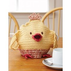 This tea cozy is an adorable decorative accent for your kitchen, adding a whimsical country feel. | Chicken Tea Cozy - Patterns | Yarnspirations | Easter  | Crochet Pattern