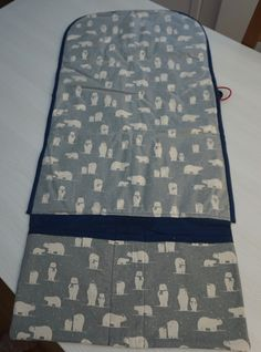 Foldable changing mat with iron on PVC coating and pockets for nappies and nappy wipes
