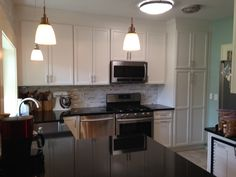 This is a custom kitchen that Woodmaster Woodworks built and installed. For your free estimate call 919-554-3707!