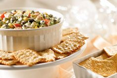 Nibble on this: avocados, beans, corn and cilantro in a chunky Tex-Mex dip. Big flavor, smart choice.