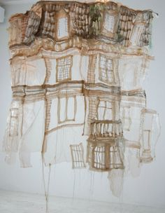 The work of young Québécois artist Jannick Deslauriers emphasizes art's most fragile elements, through a mass of translucent fabric. Her delicate fibre art spins out thread sculptures that send strong messages, covering the ghosts of cities, people and of war. (Above: The ghost of the Van Horne House, 2006-07, embroidery on tulle and organza, 60″x48″x24″)