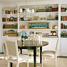I would love to have a wall of built-in shelves like this in the dining room!