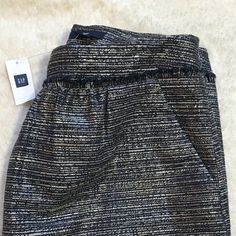 LAST CHANCE ‼️ Gap Metallic Skirt  Lowest price unless bundled!  Brand new with tags! Navy blue short skirt with silver accents. Pockets in front and zipper in back.  Happy Poshing! (✖️ trade) GAP Skirts