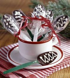 Coffeehouse Chocolate Spoons    Dip plastic spoons into chocolate, and refrigerate them for 30 minutes to allow chocolate to set up. Drizzle designs in melted white chocolate. Give them in a pretty coffee mug.    Coffeehouse Chocolate Spoons