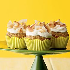 Banana cupcakes  2 cups all-purpose flour $  3/4 cup sugar $  3/4 cup toasted macadamia nuts or pecans, chopped  1 teaspoon baking soda  1/2 teaspoon salt  2 large eggs $  4 tablespoons butter, melted $  2 teaspoons orange zest $  1 (8-ounce) can crushed pineapple, drained $  2 large bananas, mashed (about 1 1/4 cups)  Cream Cheese Frosting  2/3 cup large coconut flakes, toasted