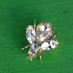 Rhinestone Fly Bug Insect Brooch by WilburVintage on Etsy https://www.etsy.com/listing/195379352/rhinestone-fly-bug-insect-brooch