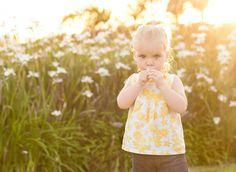Toddler smelling flower | Children photography | Sunset session | Nikkie Jean Photographer | Jacksonville, NC portrait photographer