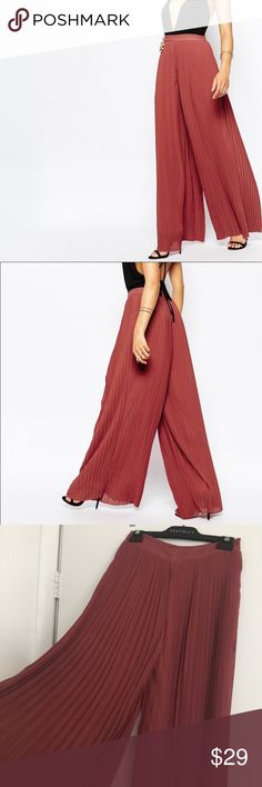 Misguided flare pants New misguided leg pleated rust color pants. They fit me a little long and a bit big on the waist. Time for a new home! Missguided Pants Wide Leg