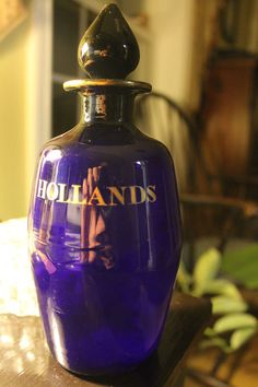 1880s branding of class. ANTIQUE COBALT BLUE Hollands LIQUOR BOTTLE Gold Letters Hand Blown Glass Stoppe