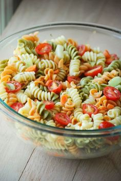 Classic Pasta Salad 1 box Tri Color Rotini Pasta 1/2 cup chopped carrots 1/2 cup grape or cherry tomatoes, halved 1/2 cup chopped cucumber 1 cup Zesty Italian Dressing: