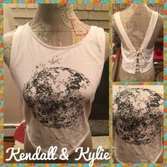 Like New Crop Tank Top with Lace Up Back Detail Like new crop tank top with lave up back.  Cream colored with black design on front.  Size large.  From Kendall & Kylie.  No trades. Will price drop if you use offer option. Kendall & Kylie Tops Crop Tops