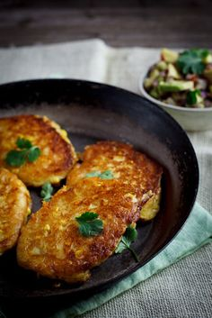 Crispy cheesy corn cakes served with spicy & zesty avocado salsa makes a perfect vegetarian lunch/light dinner.