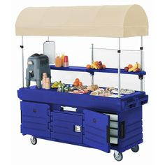 The Cambro CamKiosk KVC854C186 navy blue vending cart and canopy allows you to capture new sales in non-traditional locations! Perfect for food courts, cafeterias, university dining halls, hotel or hospital lobbies, this item lets you add a smoothie bar to your lobby or a snack stand in your student center!<br><br>Packed with useful and convenient features, the Cambro CamKiosk has all the flexibility you need to suit your particular application. This Cambro vending cart has 2 full...