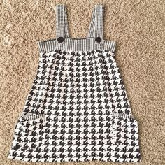 Houndstooth Printed Top Very adorable houndstooth print top. Two small functioning pockets on the front. Non-functioning button straps. Very gently used and no sign of wear or tear. Made of durable and thick material too.  Tops Tank Tops