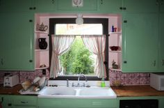 vintage kitchen - cabinet color is a little out of control, but LOVE the tin tile backsplash and woodblock counters