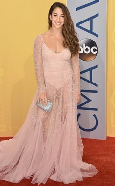 Aly Raisman from CMA Awards 2016 Red Carpet Arrivals  The Olympic gymnast sparkles from head to toe in a pink ensemble.