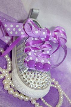 City Baby Bling Converse....might be a little over the top but you could make some cute ones