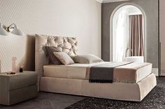 Impunto: a bed with a leather or removable fabric headboard. Characterised by a hand-buttoned workmanship that is an epitome of Italian creativity and expertise. Las Vegas Furniture Market, Closet System, Asymmetrical Design, Double Beds, The Prestige, House Rooms, Bed Design, Portfolio Design, Home Furnishings