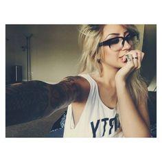 Arm full of tattoos  / glasses, girl