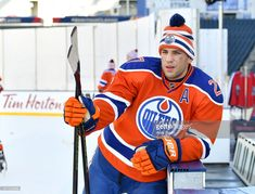Milan Lucic of the Edmonton Oilers takes a break during practice in advance of the 2016 Tim Hortons NHL Heritage Classic game at Investors Group Field on October 2016 in Winnipeg, Canada. Milan Lucic, Connor Mcdavid, Hockey Rules, Tim Hortons, Different Sports, Edmonton Oilers, World Of Sports, Hockey Players, Ice Hockey