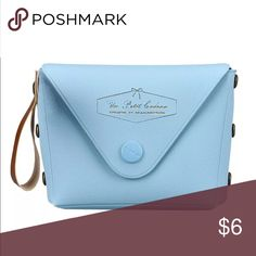 Blue Coin Bag Quaint mini bag to hold coins or small candy. Baby blue color with a snap front closing. Bags Mini Bags