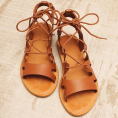 Lead the way! These Walk With Me Lace Up Sandals in tan feature a supple, faux leather material and open straps with adjustable brown laces woven through. Flat styling with a cushioned heel and rubber