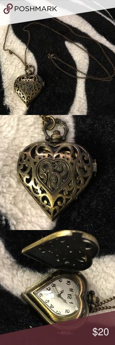 Vintage heart watch locket This is a vintage heart locket with a watch inside but it needs a new battery and the clasp is a little loose so may not stay closed. Jewelry Necklaces