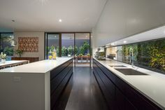 Like the white cabinetry with wood (although probably prefer lighter wood). Black full height door frames look good. Armadale | Canny