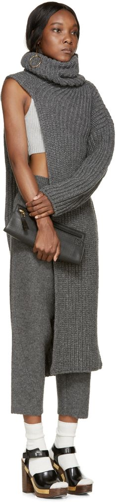 Overlong single sleeve fisherman's knit turtleneck in grey. Tonal stitching.