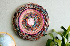 collaborative knitting and weaving project. finger knit individual strands. weave onto a hula hoop warped with tshirt material.   http://www.flaxandtwine.com/2012/02/woven-finger-knitting-hula-hoop-rug-diy/