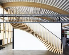 Bamboo staircase with stainless steel handrail.