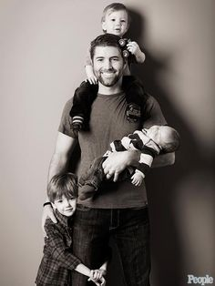 I love this! The portrait of fatherhood in this beautifully unique photo of Josh Turner and his sons. It's only accentuated by the fact that he seems to have all his priorities straight-from faith to family to values.