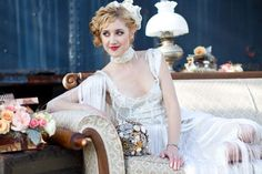 http://intrigue-designs.com/ Gatsby bride with a brooch bouquet