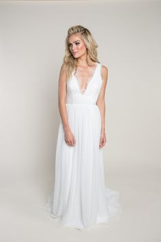 V-Neck Wedding Dress with Lace | Willow Darling | This v-neck, sheath wedding dress features a plunging v-neckline with a soft scallop edging and beaded lace bodice. A tiny ribbon follows the neckline to a see-through handkerchief panel that lies on the shoulders and ties at the back. The chiffon skirt has a sweep train. Visit our webiste to learn more about this lace wedding dress with cut-out back. #wedding #weddinginspo #bride #bridalinspo #bridal #weddingdress #lace #vneck #boho V Neck Wedding Dress, Custom Wedding Dress, Bridal Wedding Dresses, Lace Wedding, Beaded Chiffon, Chiffon Skirt, Beaded Lace, Gowns With Sleeves, Lace Bodice