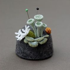 Sea life pin cushion. this would be perfect for your endangered species project in handwork :) y'all could needle felt the coral...