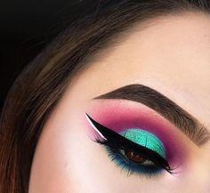 Metallic green and bold pink matte eyeshadow with winged eyeliner
