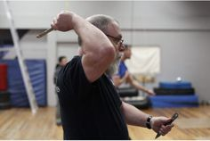 Steve Leeds prepares to throw a knife during an evening hosted by Zirger Academy of Martial Arts to teach people the basics of knife throwing. Academy Of Martial Arts, Knife Throwing, Good News Stories, Leeds, Addiction, Teaching, Feelings, People, Learning