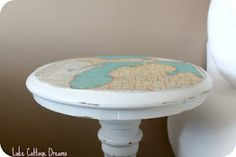 Mod podge map table. This could be cute between our chairs... maybe black with sheet music.