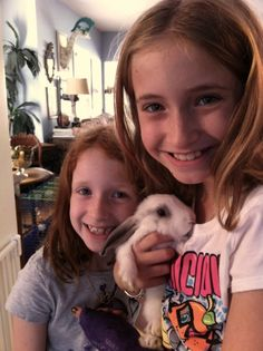 Two happy girls, one happy bunny. Happiness provided by The Animal Store. #pets #animals #WordlessWednesday