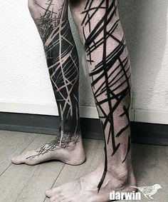 Very original use of the negative spaces on one leg and copy it on the other one. Some people are just brilliant. Unique tattoo.