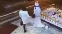 Woman Suffers Instant Karma After Attacking An Innocent Snowman For No Reason