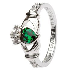 This gorgeous Claddagh birthstone ring is the essential choice for any Celtic lover born in May. The stunning green emerald sits inside a delicate heart, held by hands and adorned with a stunning crown. The traditional Claddagh design meets the excitement of a birthday in a classy, refined but fun way. The delicately designed hands have been made to exalt any of Shanore's 12 birthstone choices.Symbols in JewelryThe Claddagh symbol represented here stresses the importance of love, loyalty and ...
