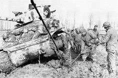 """""""Green Hell"""".The Battle of the Hürtgen Forest - man look at that mud and having to repair a track in it!"""