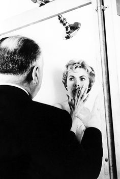 Alfred Hitchcock giving direction to Janet Leigh for the famous 'shower scene', on the set of 'Psycho', 1960. °